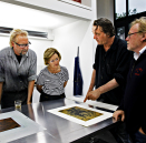 Ole Larsen, Queen Sonja, Kjell Nupen and Ørnulf Opdahl working on the project. Published 25.06 2011. Handout picture from the Royal Court. For editorial use only - not for sale. Photo: Rolf M. Aagaard / the Royal Court.